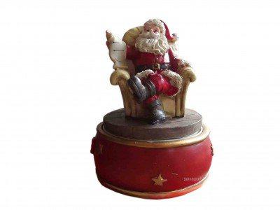 Santa Claus im Sessel auf Weihnachts-Spieluhr